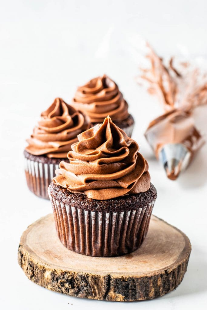 Nutella frosting piped on top of chocolate cupcakes