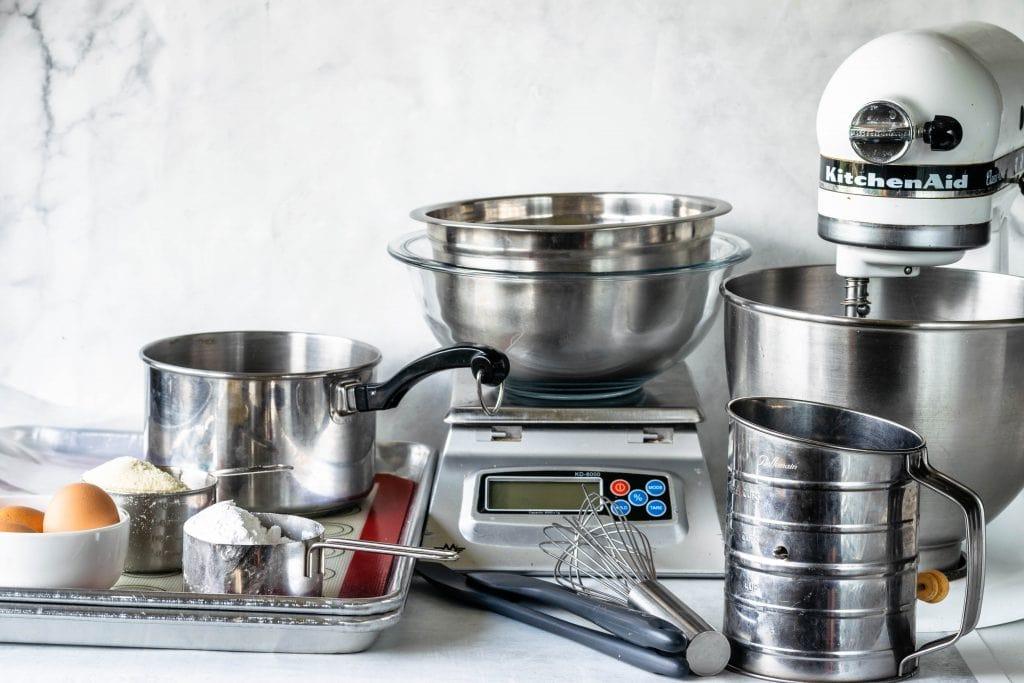 macaron equipments: eggs, scale, baking sheets, spatula, sifter, scale, mixer