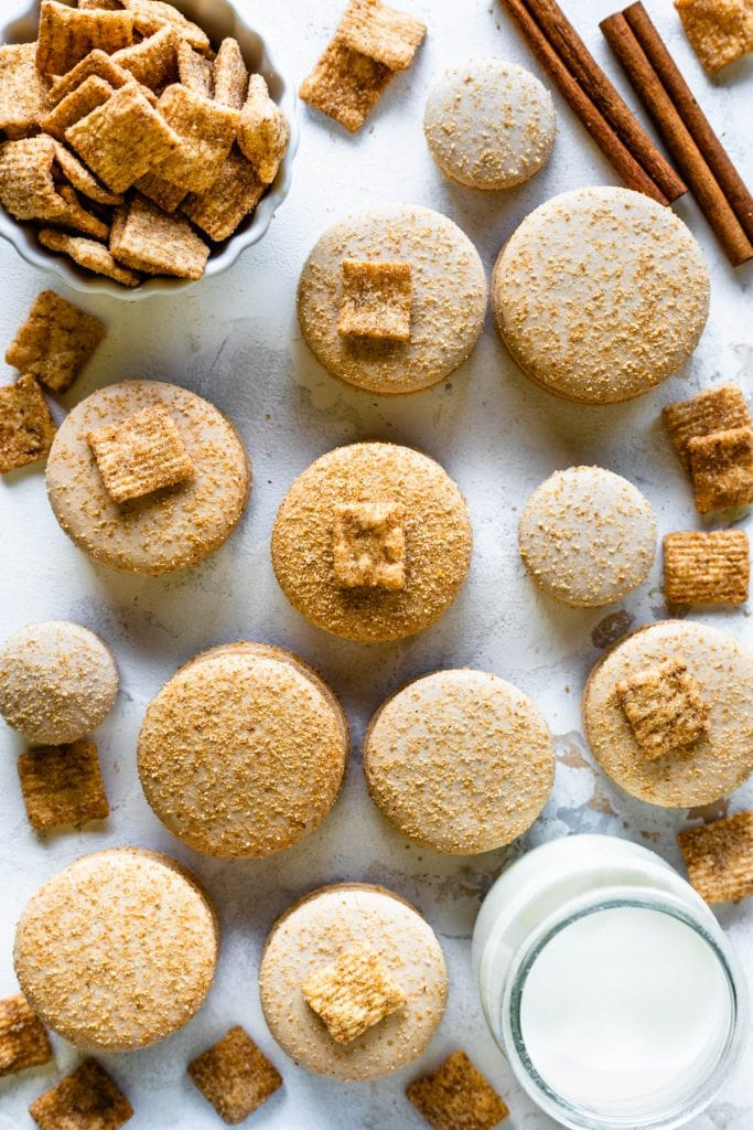 Cinnamon Toast Crunch Cereal macarons dusted with cinnamon toast crunch cereal powder, filled with cinnamon toast crunch buttercream