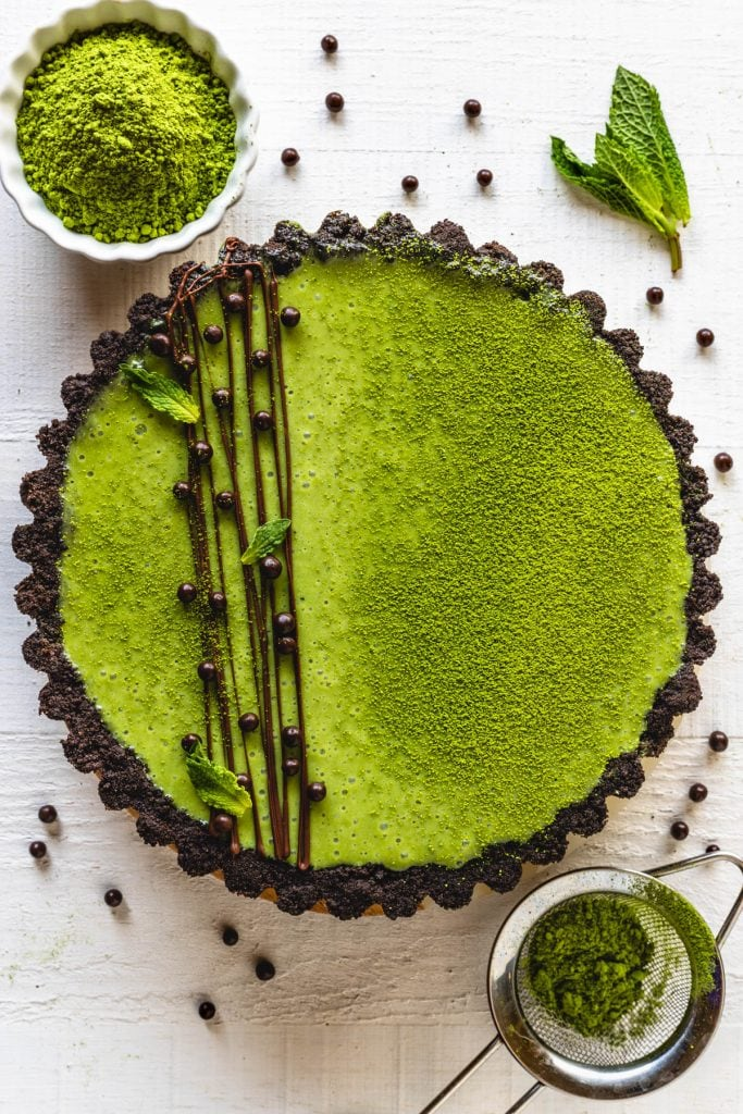 green tea Pie with oreo crust and drizzled with chocolate and callebaut crispearls