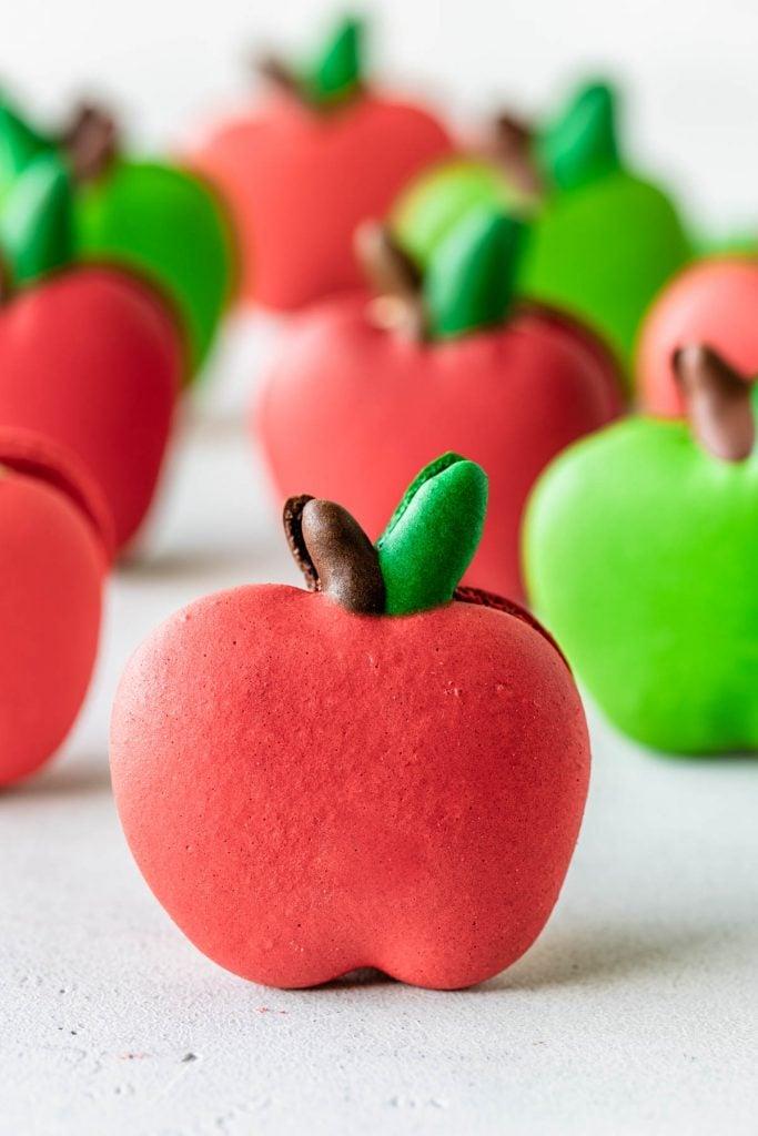 caramel apple macarons shaped like apples.