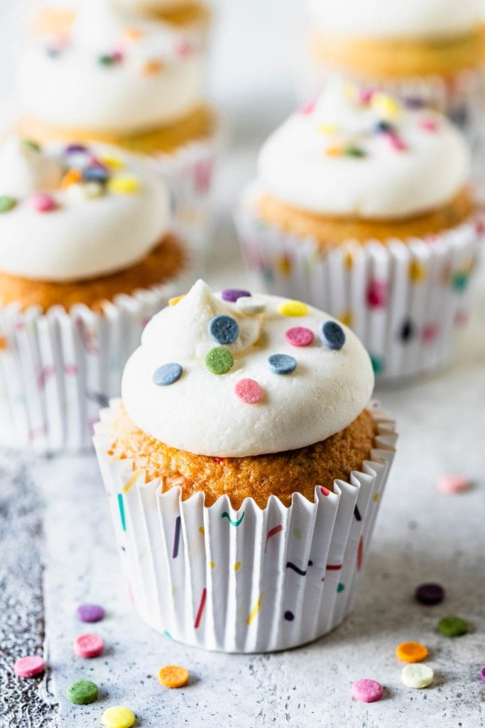 cupcakes with frosting on top and funfetti sprinkles.