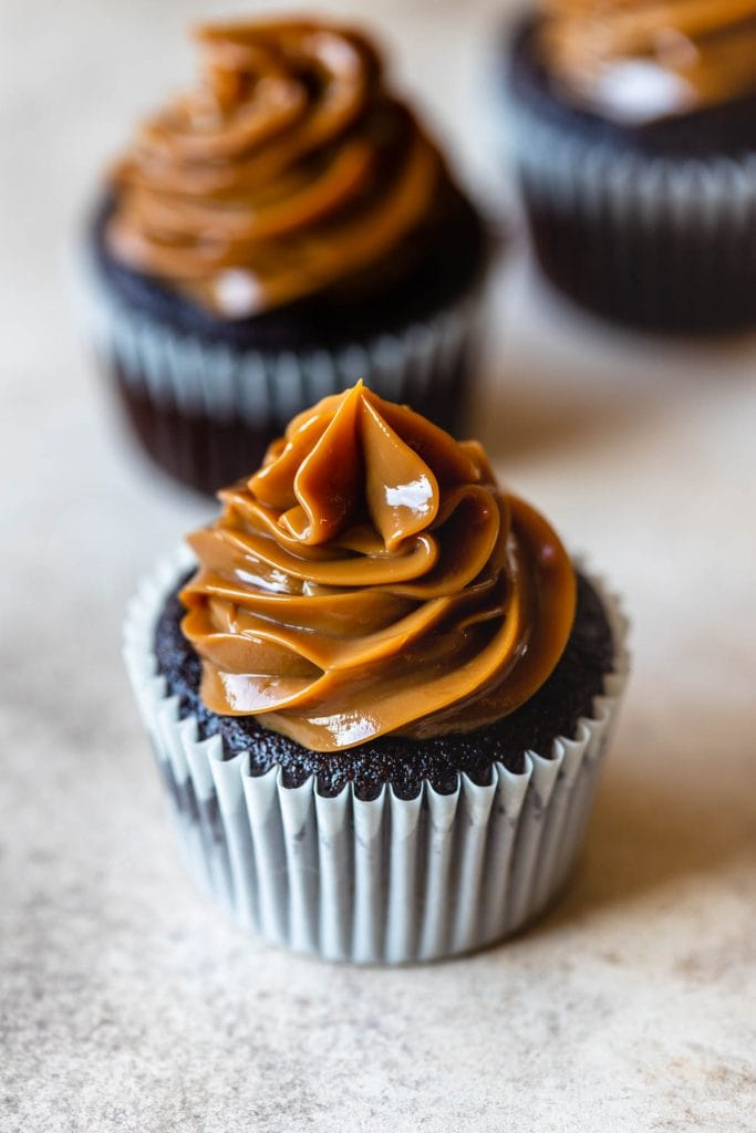 cupcake with instant pot dulce de leche piped on top.