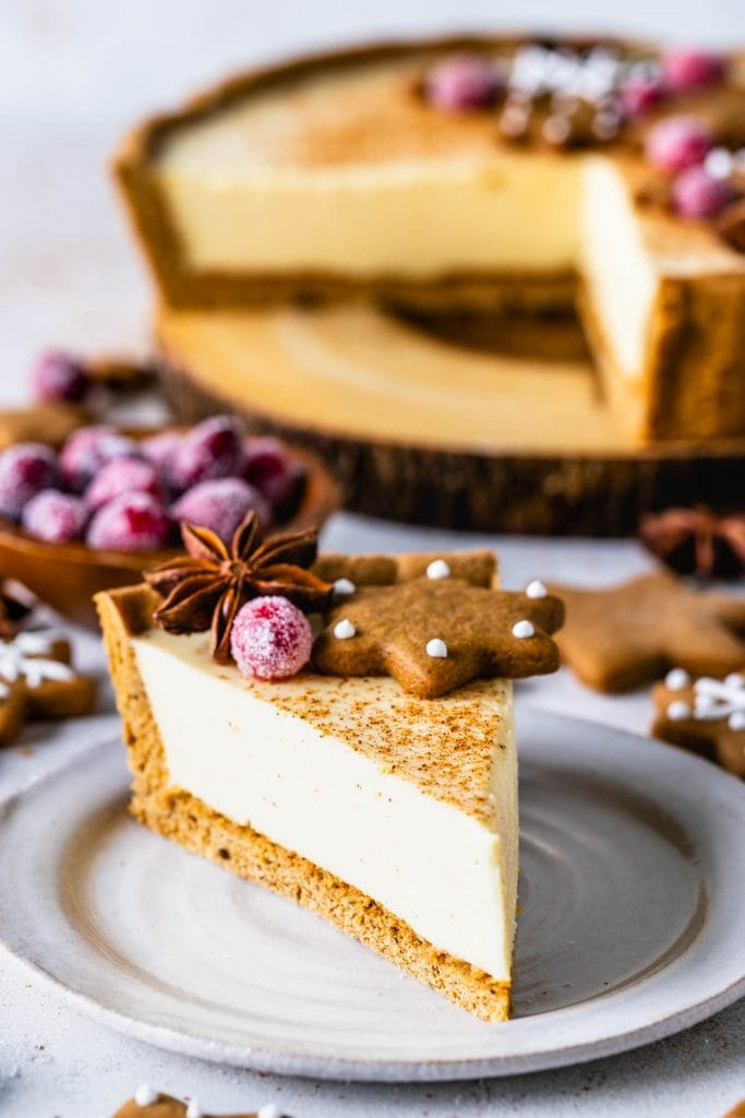 slice of eggnog pie topped with gingerbread cookies and sugared cranberries.