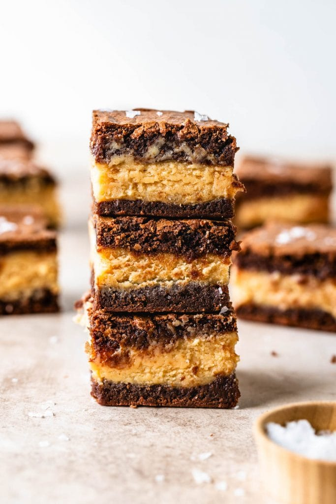 3 peanut butter stuffed brownies stacked on top of each other.