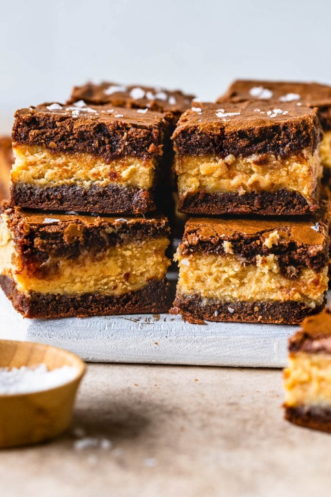 peanut butter filled brownies stacked on top of each other.