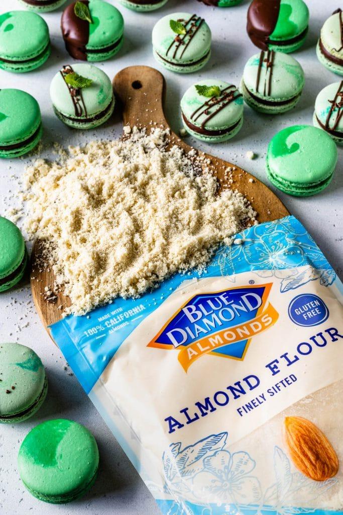 bag of almond flour with macarons around.
