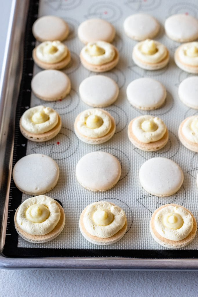 macaron shells filled with pastry cream and french buttercream.