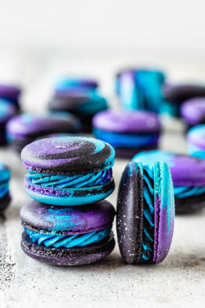 Galaxy Macarons purple, black, and blue macarons with silver shimmer.