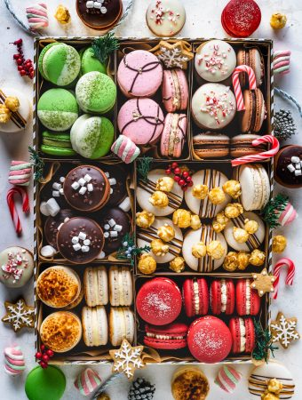 assorted holiday macarons in a box.