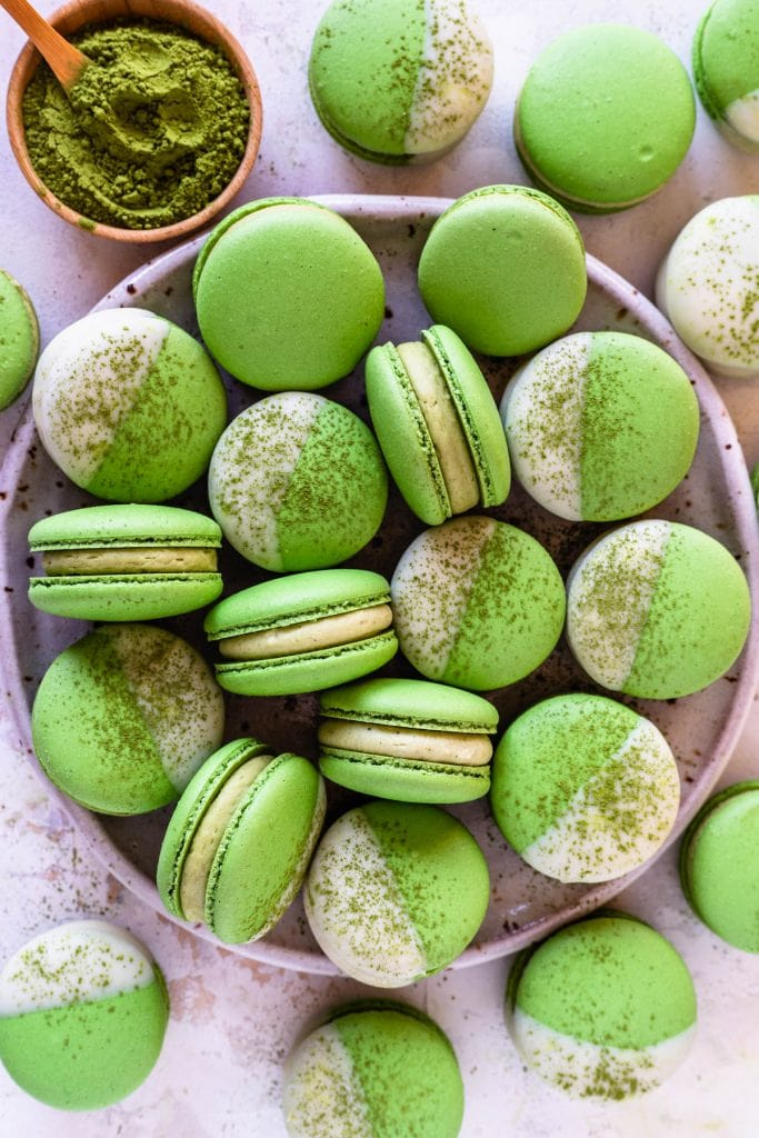 matcha macarons that were included in a holiday macaron box.