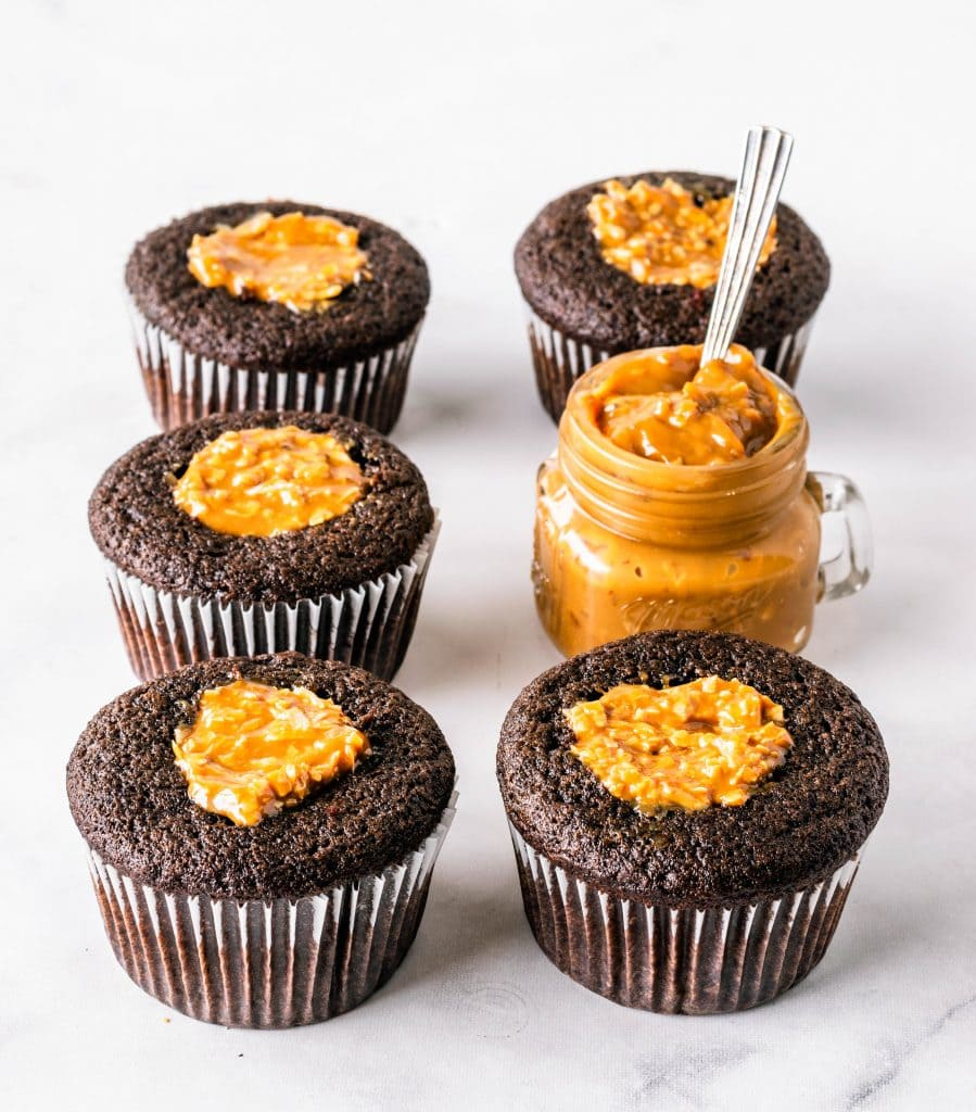 cupcakes filled with coconut and dulce de leche.