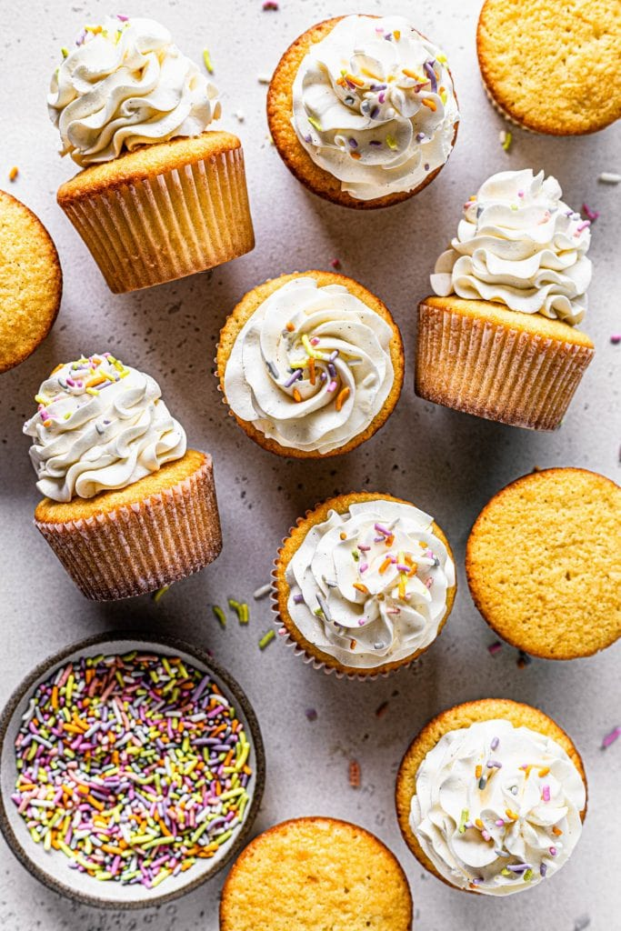 vanilla cupcakes topped with sprinkles.