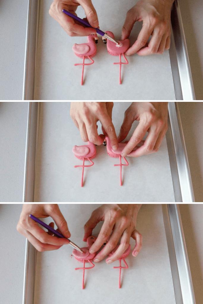 placing wings on flamingo macarons.