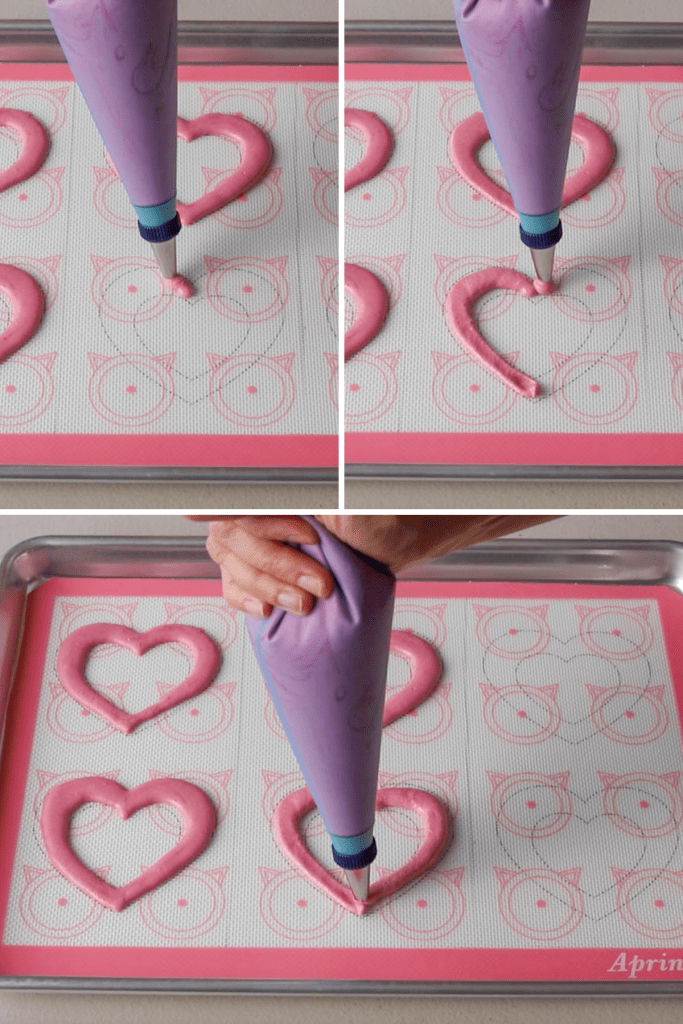 picture showing how to pipe hearts with macaron batter.