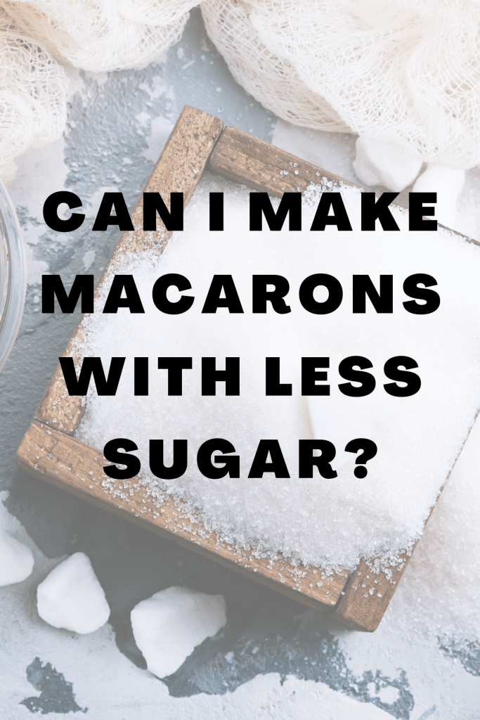 """""""Can I make macarons with less sugar"""" saying on a background of picture of sugar."""