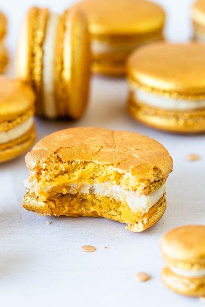 gold macaron bitten.