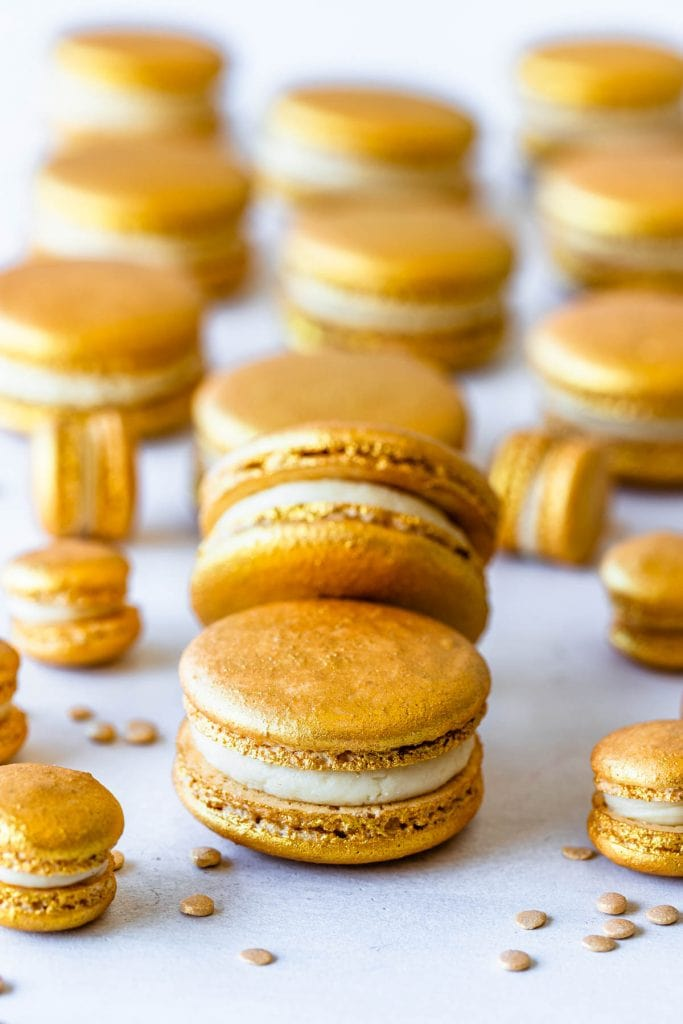 golden macaron shells filled with baileys ganache.