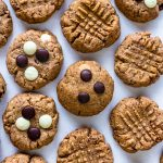 cookies made of macaron flour topped with chocolate chips or with a criss cross pattern.