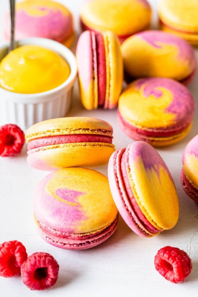 Mango Raspberry Macarons with bicolor shells pink and yellow.