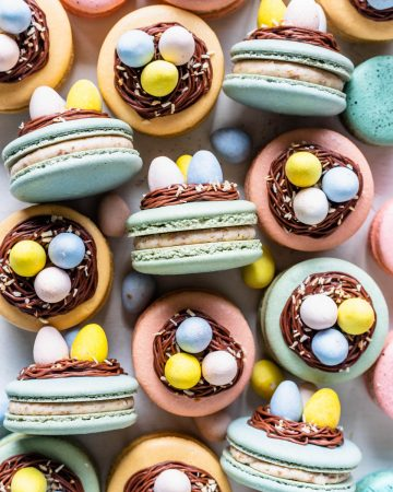 macarons topped with a nest made out of chocolate frosting, and cadbury eggs.
