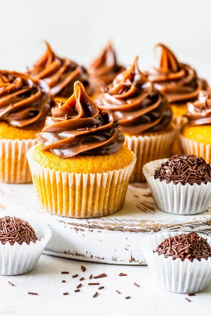 Carrot cupcakes topped with brigadeiro.