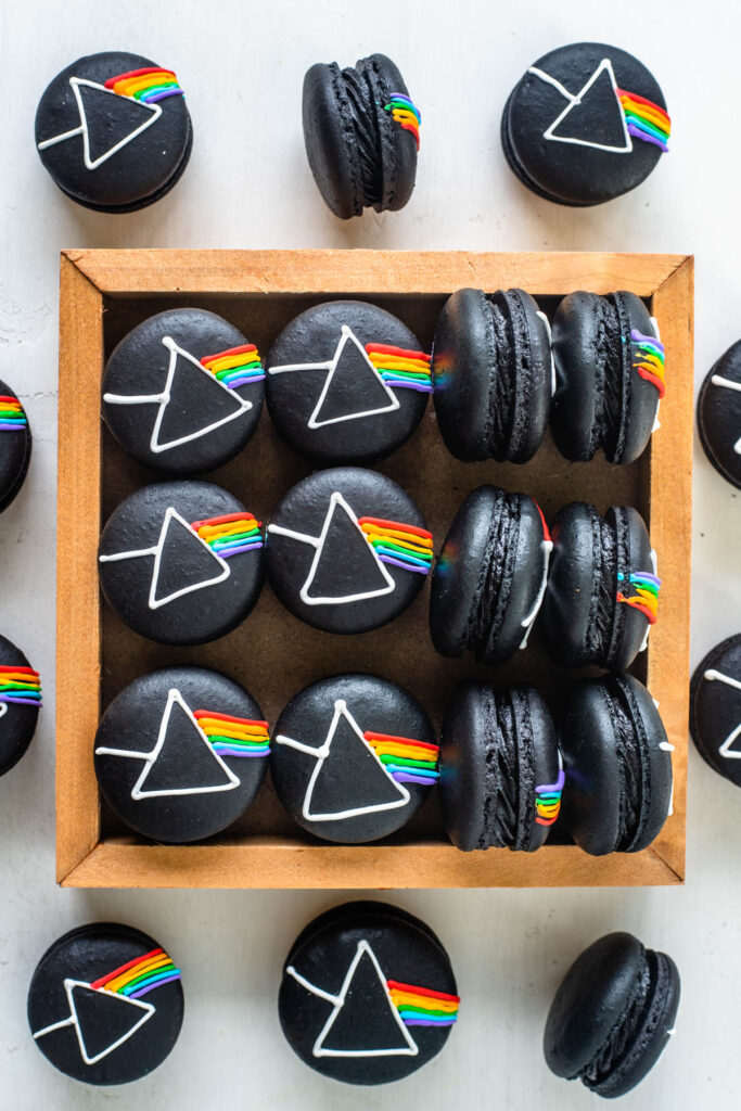 Pink Floyd Macarons, black macarons with the pink floyd logo drawn on top with royal icing.