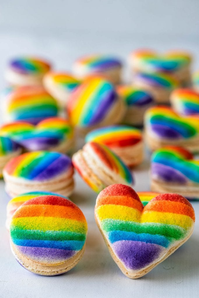 pride macarons, heart and circle shaped macarons with a rainbow decoration.