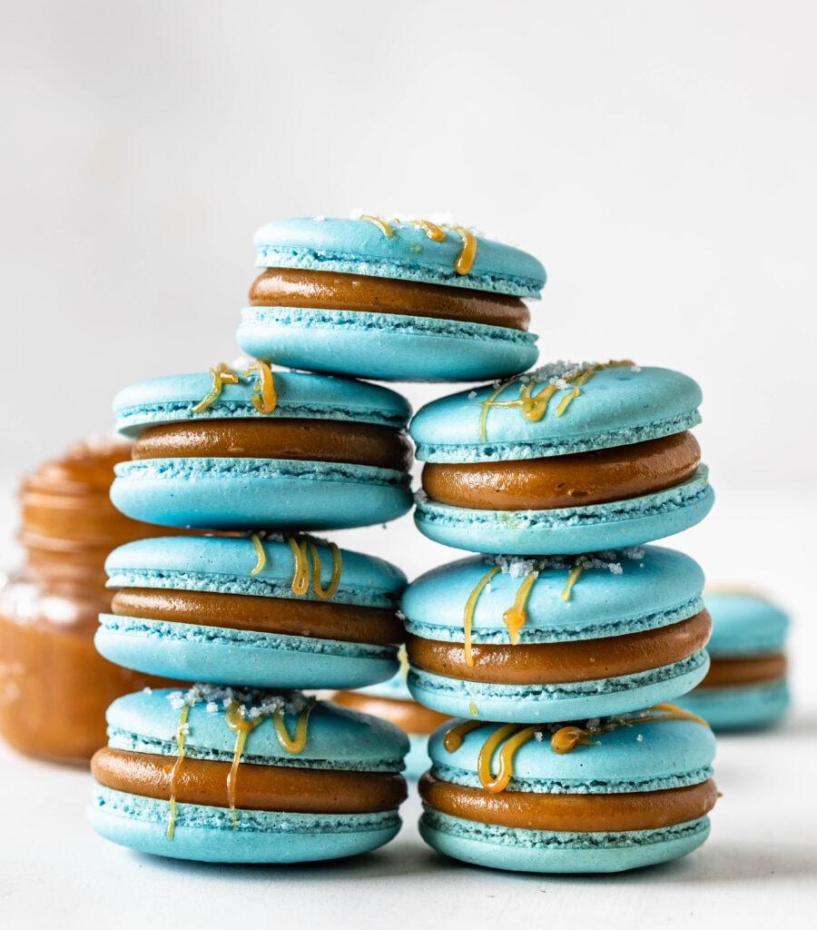 blue macarons filled with caramel sauce.