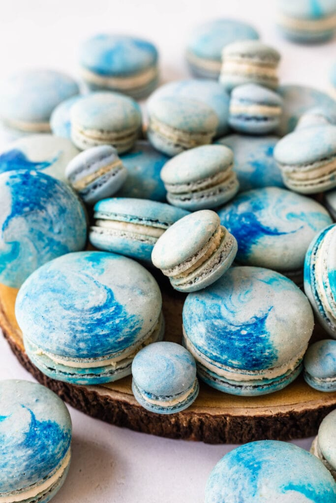 blue macarons with painted shells.