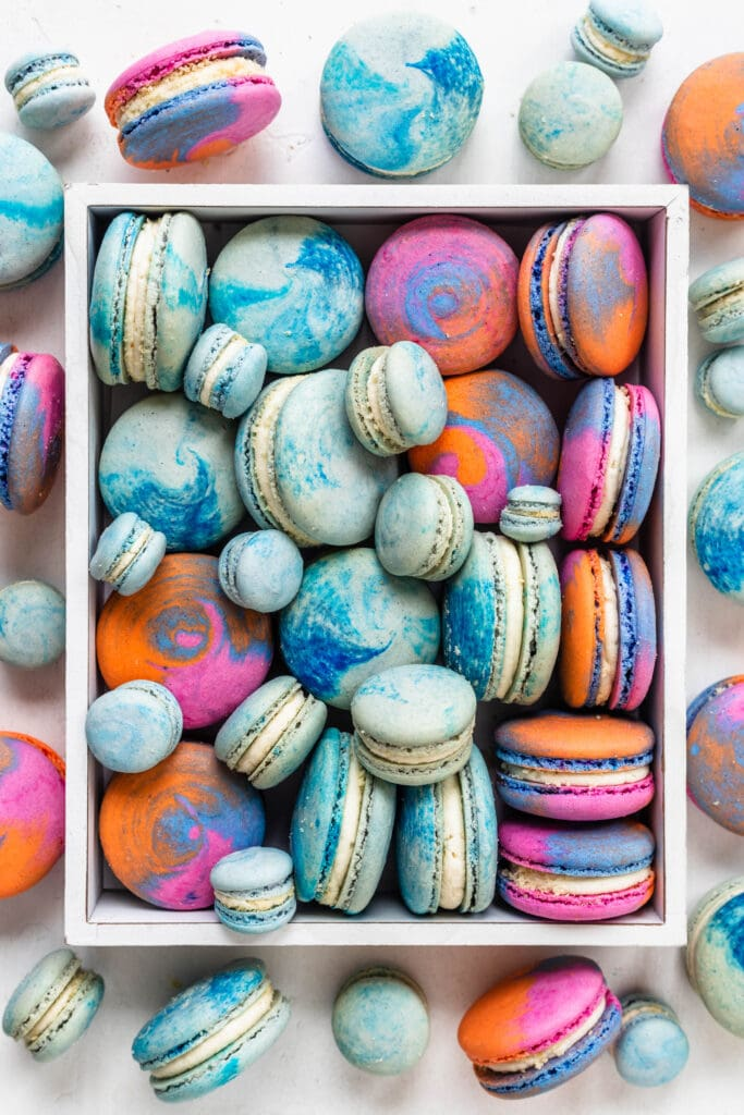 colorful macarons, pink, blue, teal, yellow.