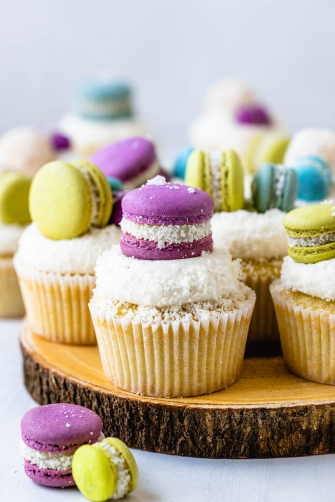 coconut cupcakes topped with macarons.